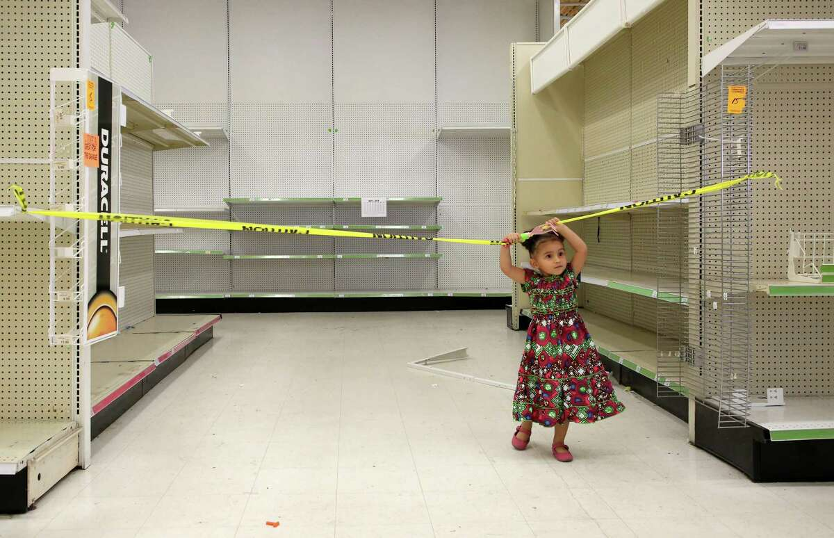 Two-year-old Sparrow Simon plays in an empty isle of the Toys R Us store on Westheimer Road Thursday, June 28, 2018, in Houston. The company is closing nationwide this week. ( Godofredo A. Vasquez / Houston Chronicle )