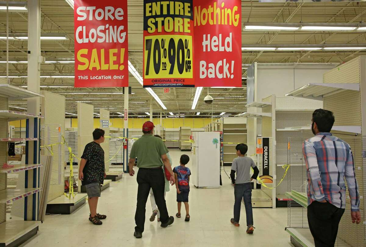 Shoppers walk through a mostly empty Toys R Us store on Westheimer Road Thursday, June 28, 2018, in Houston. The company is closing nationwide this week. ( Godofredo A. Vasquez / Houston Chronicle )