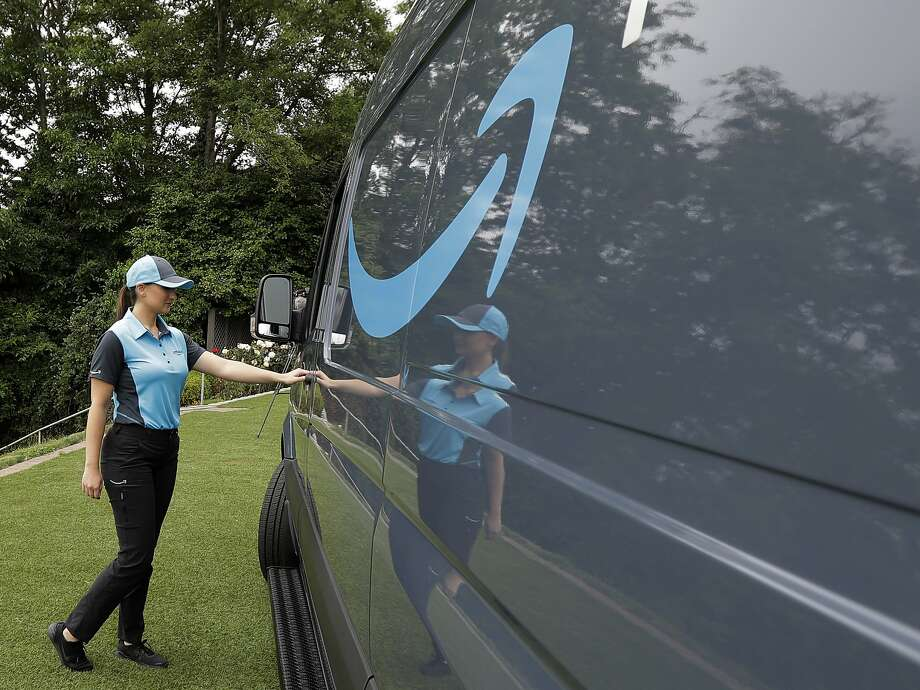 Amazon- Brand delivery trucks are shown by the company at a media event in Seattle. Amazon wants entre Preneurs are working on the delivery of their packages. Photo: Ted S. Warren / Associated Press
