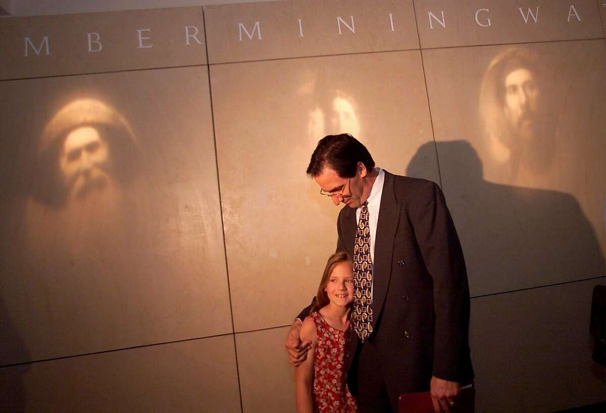Stephen Sposato hugged his daughter Meghan, 8, after their hearing before the California Supreme Court in 2001. Sposato, who lost his wife in the 101 California St. mass shooting in 1993, was arguing that gunmaker Navegar should be held liable for making the weapon that killed his wife.