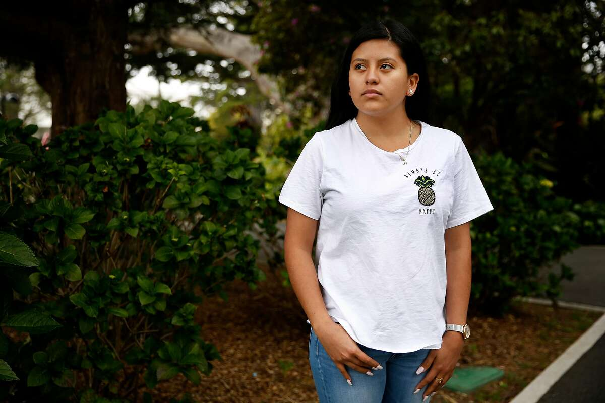 Victoria Romero, 20, stands for a portrait at San Francisco State University, Tuesday, May 8, 2018, in San Francisco, Calif. A group of four La Taqueria employees successfully complained to the city and state about unpaid overtime, sick time and healthcare benefits, forcing owner Miguel Jara to pay $500,000 in damages. Victoria was the youngest of the women, a criminal justice student who worked there for a year.