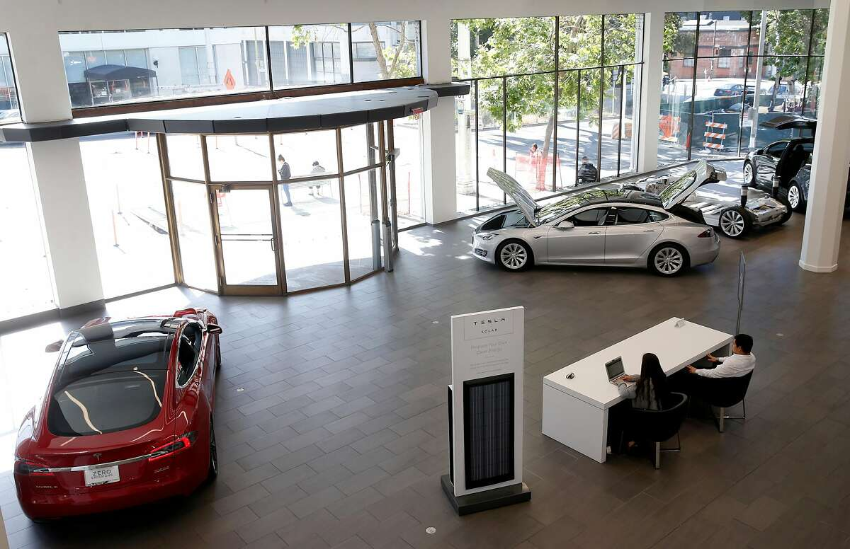 A solar panel is displayed at the Tesla store in San Francisco, Calif. on Thursday, June 28, 2018. Tesla is selling solar products from recently acquired SolarCity directly in its automobile showrooms.
