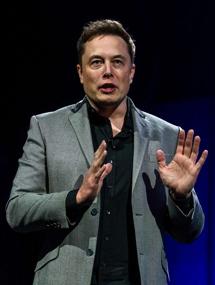 Elon Musk, CEO of Tesla Motors Inc., unveils the company�s newest products, Powerwall and Powerpack in Hawthorne, Calif., Thursday, April 30, 2015. Musk is trying to steer his electric car company's battery technology into homes and businesses as part of an elaborate plan to reshape the power grid with millions of small power plants made of solar panels on roofs and batteries in garages. (AP Photo/Ringo H.W. Chiu) Photo: Ringo H.W. Chiu / Associated Press 2015