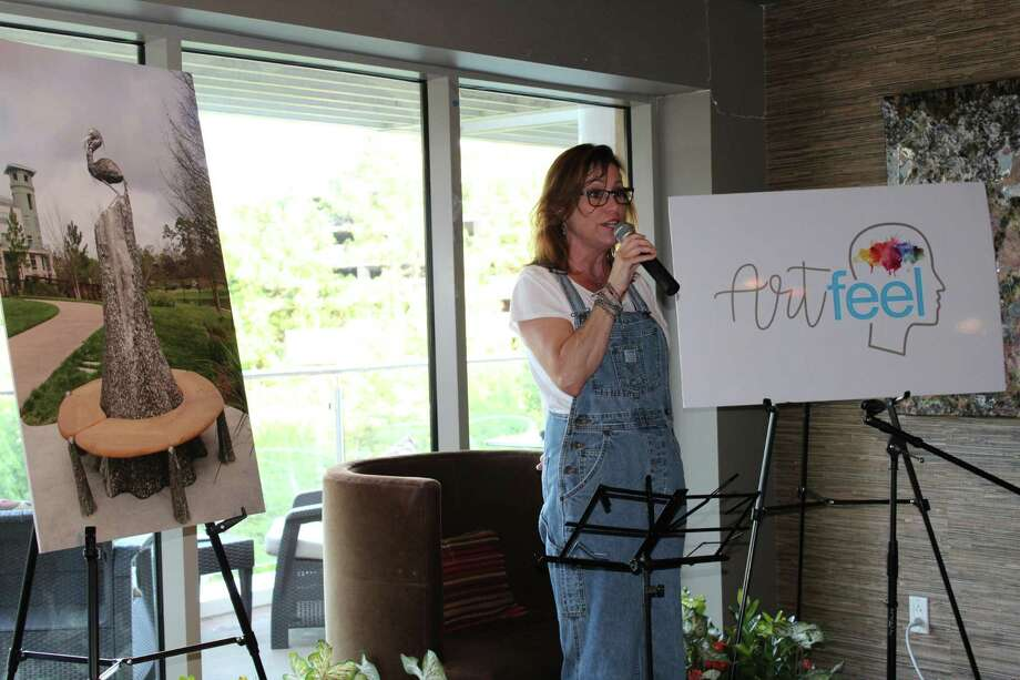Ruth Hallaway, owner of Crush Wine lounge, welcomes guests to ArtFeel Live on Wednesday, June 27, 2018. Photo: Patricia Dillon / The Woodlands Villager