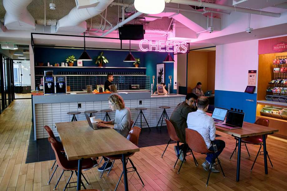 WeWork members use a common room at the company's Embarcadero Center space in San Francisco in 2017. Photo: Michael Short / Special To The Chronicle 2017