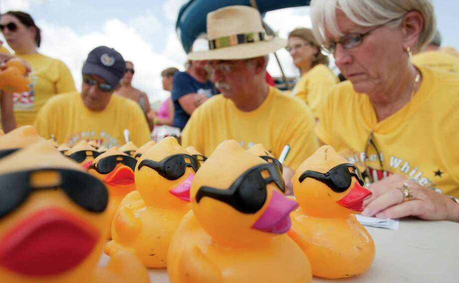 Rubber ducks sit on a table as volunteers record the top finishers Rob Fleming Aquatic Center during a previous Crisis Assistance Center Duck Race. This year's Duck Race will be on Aug. 25 instead of July 4. Photo: Eric S. Swist / Staff Photo By Eric S. Swist / Staff photo by Eric S. Swist