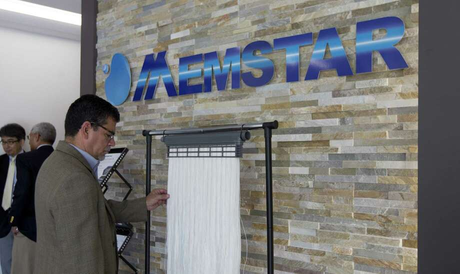 Conroe City Manager Paul Virgadamo Jr. examines membranes used in water filtration and desalination during a grand opening for Memstar USA's new 40,500 square-foot facility in the Conroe Park North Industrial Park on Friday, June 29, 2018, in Conroe. The plant, part of the Beijing-based CITIC Envirotech Group, will produce reverse osmosis membranes for water filtration and desalination. Photo: Jason Fochtman, Staff Photographer / Houston Chronicle / © 2018 Houston Chronicle