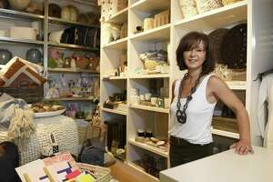 Owner Kim Caravella poses at the new Habitat Greenwich interior design store in the Cos Cob section of Greenwich, Conn. Tuesday, June 26, 2018. The shop, which will have its soft opening Saturday, June 30, features a variety of interior pieces from near and far, many of which are made by fair trade small businesses.