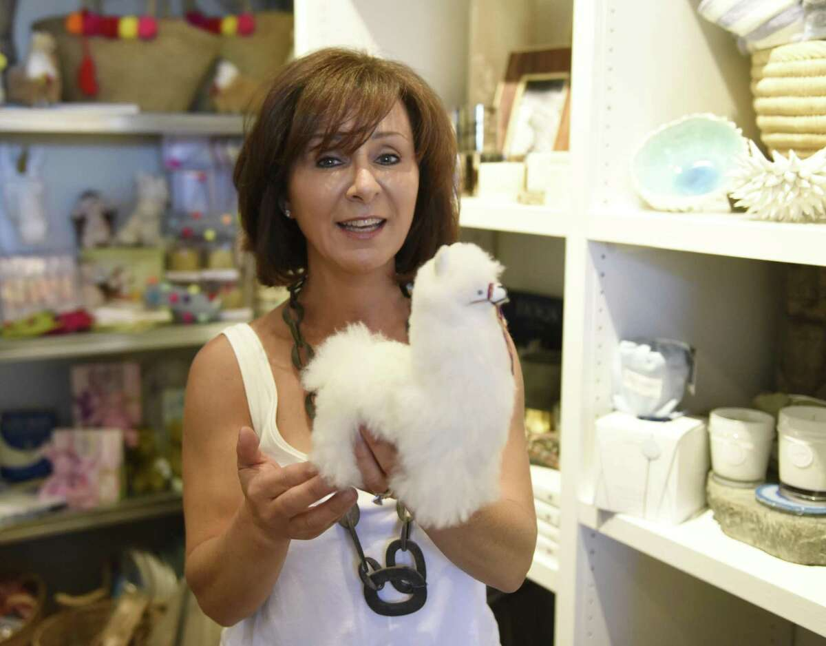 Owner Kim Caravella shows an alpaca decoration made from alpaca's wool at the new Habitat Greenwich interior design store in the Cos Cob section of Greenwich, Conn. Tuesday, June 26, 2018. The shop, which will have its soft opening Saturday, June 30, features a variety of interior pieces from near and far, many of which are made by fair trade small businesses.