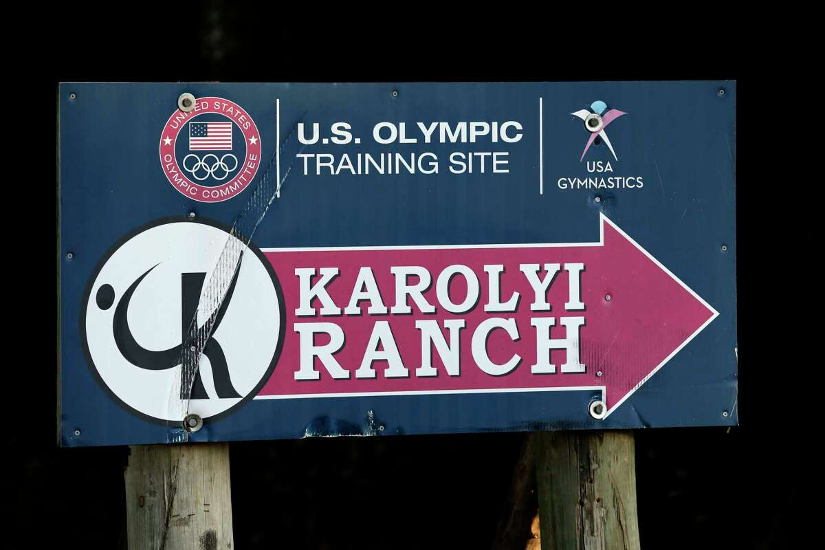 FILE - In this Sept, 12, 2015, file photo, a sign points to the Karolyi Ranch near New Waverly, Texas. Investigators in Texas on Friday, June 29, 2018, are expected to address allegations of criminal behavior by disgraced former sports doctor Larry Nassar at the famed gymnastics training center run by Bela and Martha Karolyi. The facility has since closed and Nassar has been imprisoned for life. (AP Photo/David J. Phillip, File)