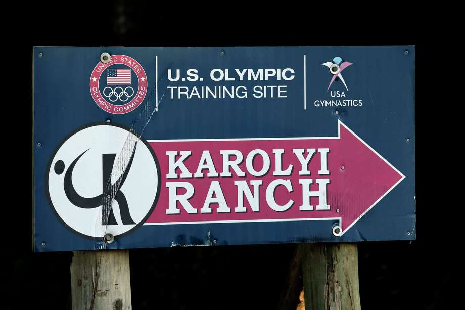 In this Sept, 12, 2015, file photo, a sign points to the Karolyi Ranch near New Waverly, Texas. Investigators in Texas on Friday, June 29, 2018, are expected to address allegations of criminal behavior by disgraced former sports doctor Larry Nassar at the famed gymnastics training center run by Bela and Martha Karolyi. The facility has since closed and Nassar has been imprisoned for life. Photo: David J. Phillip, Associated Press / Copyright 2018 The Associated Press. All rights reserved.