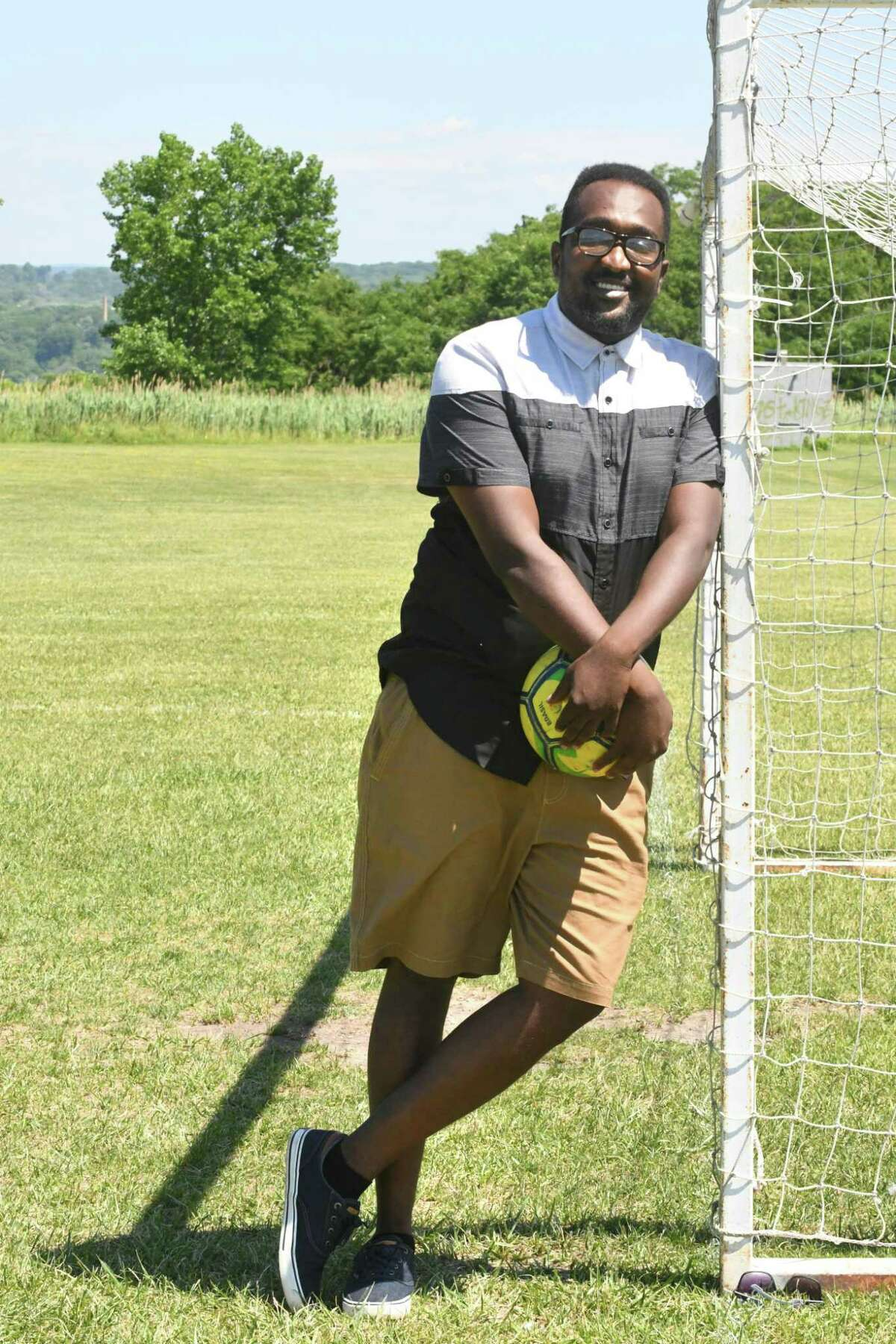 Soccer coach Coach Amjad Abdalla stands at the goal at Hoffman Park on Friday, June 29, 2018 in Albany, N.Y. (Lori Van Buren/Times Union)