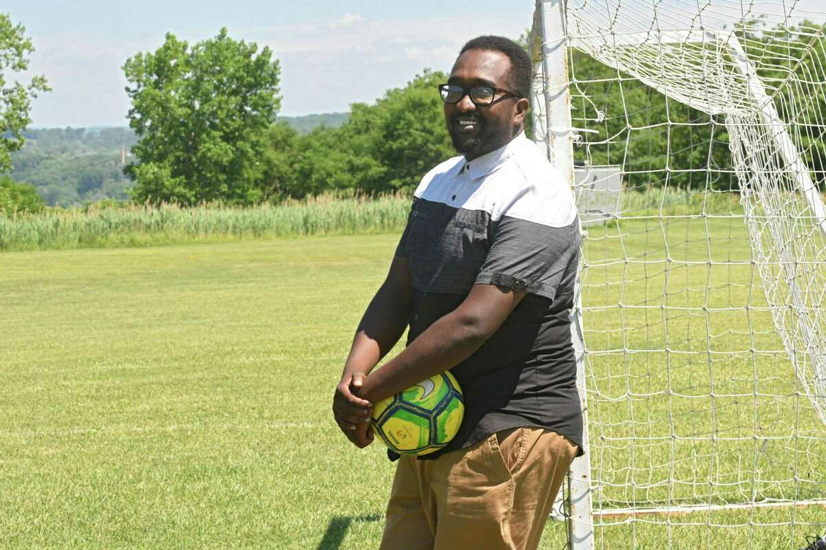 Soccer coach Amjad Abdalla started the RISSE Soccer Team three years ago, and made it his mission to help his players come of age in the U.S. while straddling multiple cultures.(Lori Van Buren/Times Union)