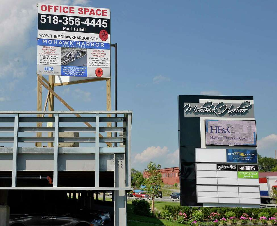 Signs outside the Mohawk Harbor complex Friday June 29, 2018 in Schenectady, NY. (John Carl D'Annibale/Times Union)