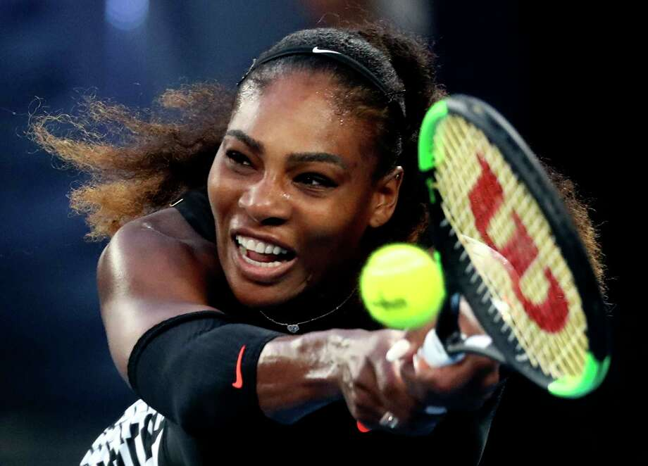 FILE - In this Jan. 28, 2017, file photo, United States' Serena Williams makes a backhand return to her sister Venus during the women's singles final at the Australian Open tennis championships in Melbourne, Australia. Serena Williams is expected to compete in the Wimbledon tennis tournament that begins Monday, July 2, 2018. Photo: Aaron Favila, AP / Copyright 2017 The Associated Press. All rights reserved.