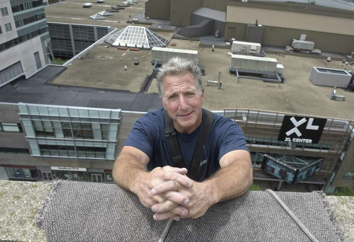 Republican Matthew Corey, a window-washer who is challenging Chris Murphy for his U.S. Senate seat hangs over the side of a Trumbull Street building in Hartford, Conn, Wednesday, June 27, 2018.