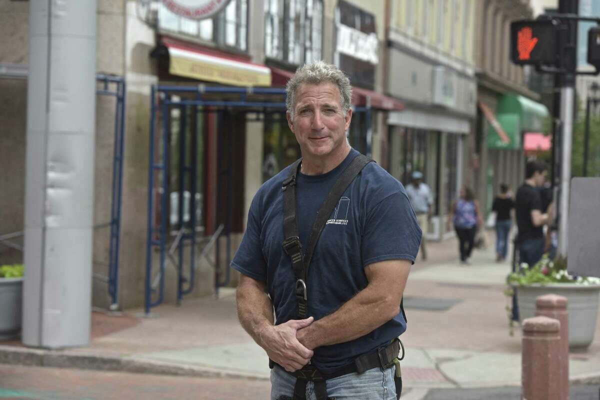 Republican Matthew Corey is a window-washer who is challenging Chris Murphy for his U.S. Senate seat. He waas washing windows on a Trumbull Street building in Hartford, Conn, Wednesday, June 27, 2018.