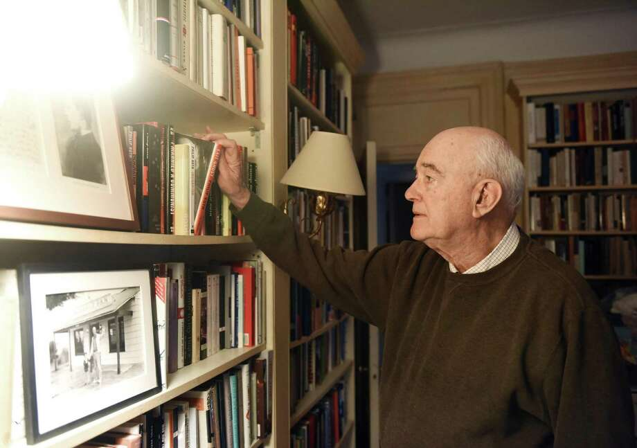 Former publisher of the Greenwich Time and Stamford Advocate Steve Isenberg looks through books in the library of his Upper West Side home during a recording for the new Rally podcast in New York, N.Y. Wednesday, April 25, 2018. Hearst Connecticut Media business reporter Macaela Bennett is recording and producing a new podcast in which business people describe the challenges they've encountered in their rise to success. Photo: Tyler Sizemore / Hearst Connecticut Media / Greenwich Time