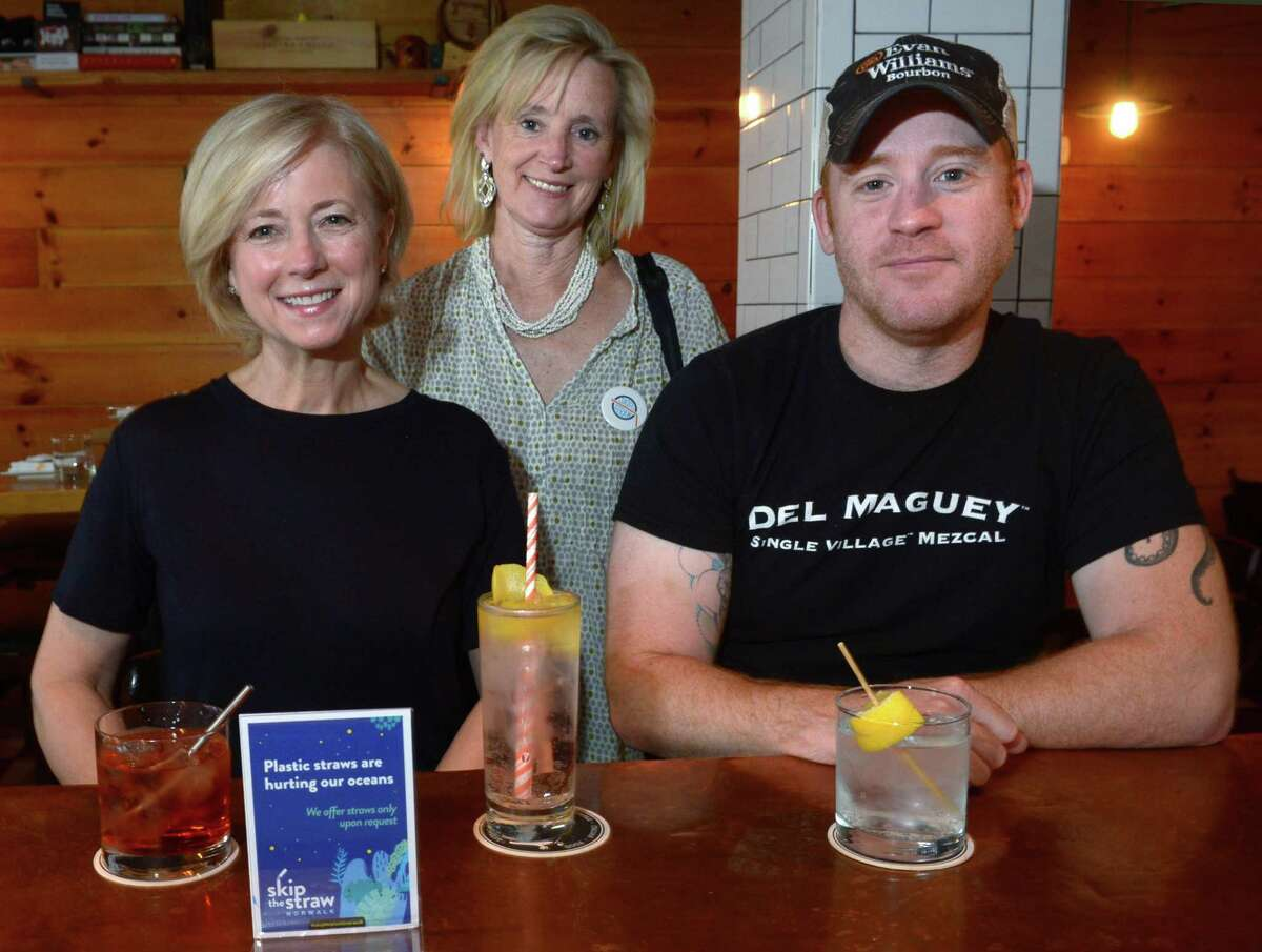 Bar Sugo owner Adam Roytman, right, announces the partnership with Skip the Plastic Norwalk founders Betty Ball and Wendell Livingston at his restaurant Wednesday, June 27, 2018, in Norwalk, Conn. Skip the Plastic Norwalk, who hopes to reduce plastic pollution and harm to wildlife, is kicking off the summer with a campaign, Skip the Straw. We're meeting at Bar Sugo because it is one of the places participating, and Wendell and Betty Ball,