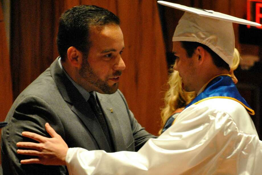 Danbury Board of Education member Farley Santos congratulates graduate Trevor Dyer and tells him how much he admired his late father, former Danbury Mayor James E. Dyer Photo: /Contributed Photo
