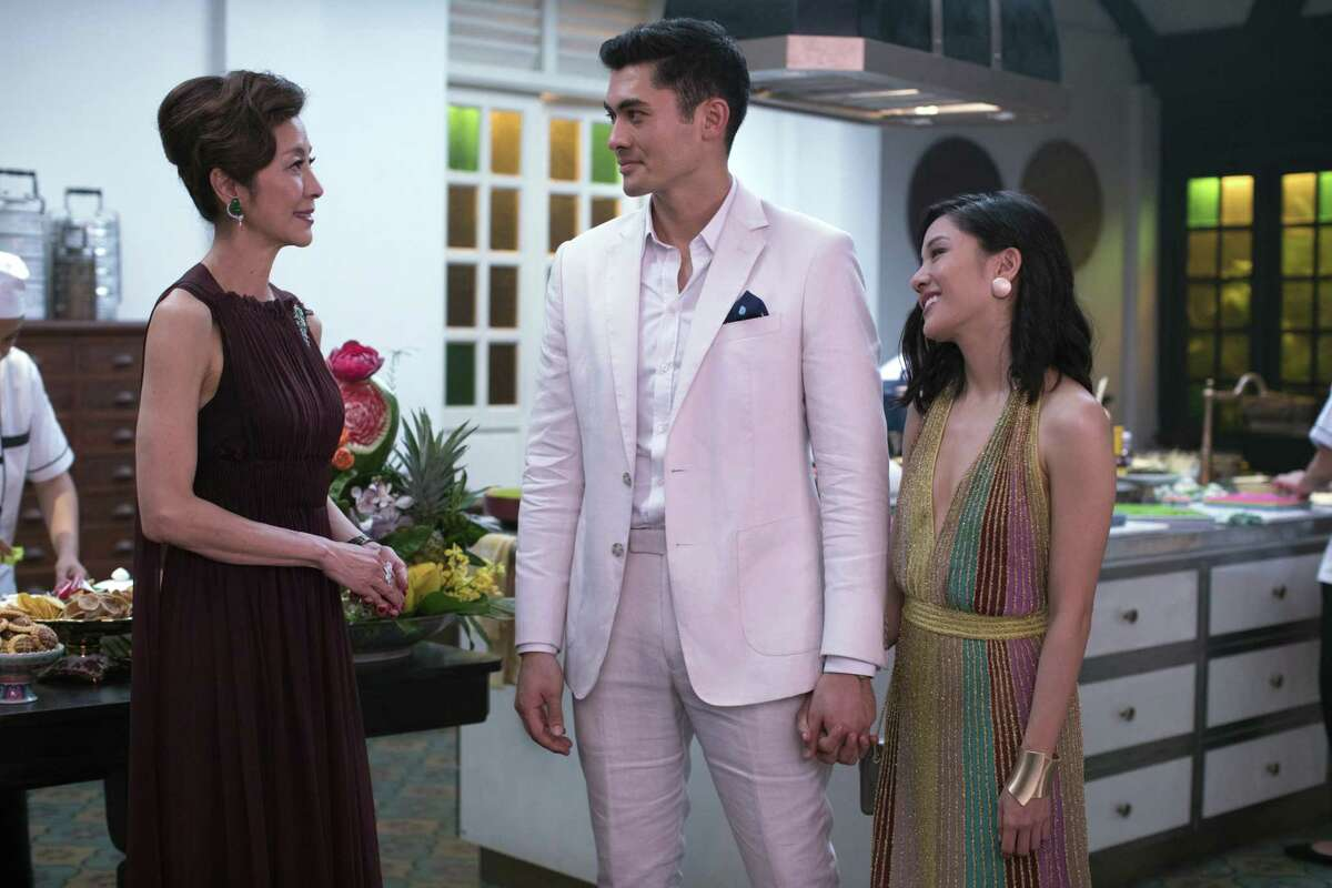 """Michelle Yeoh, left, Henry Golding and Constance Wu star in """"Crazy Rich Asians,"""" in theaters on Aug. 17."""