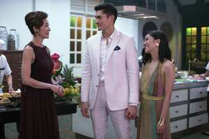 "Michelle Yeoh, left, Henry Golding and Constance Wu star in ""Crazy Rich Asians,"" in theaters on Aug. 17."