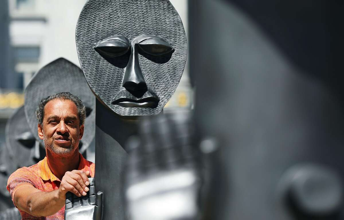 Zak Ov� poses for a portrait with his art installation,