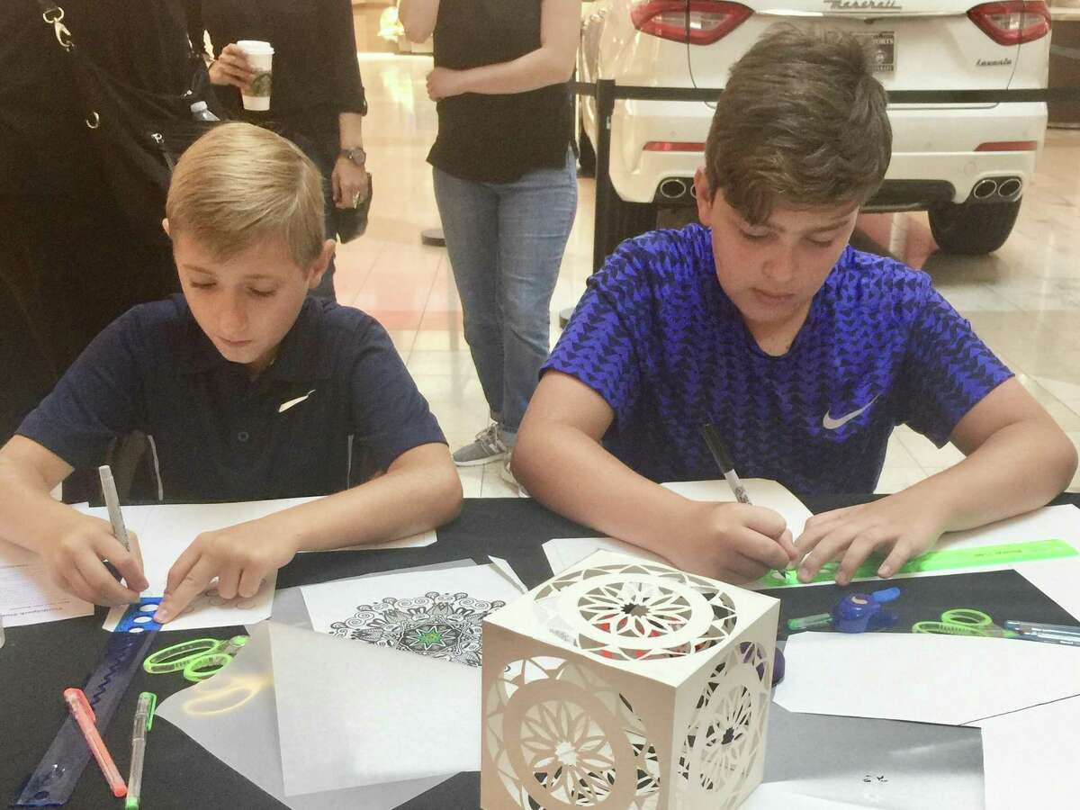 Two students enjoy participating in last year's Free Summer Workshop Event sponsored by The Woodlands Arts Council at The Woodlands Mall. This year's event is slated for July 28, between 10 a.m. and noon, and is free of charge.