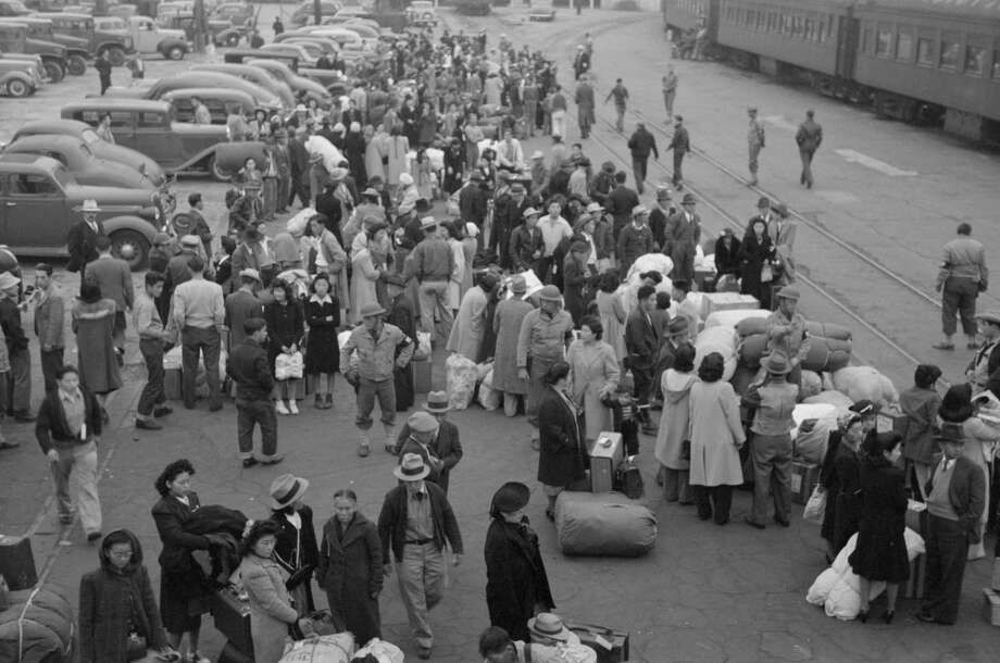 In a photo provided by Russell Lee and the Library of Congress, Japanese-Americans under forcible relocation from the U.S. West Coast to internment camps during World War II. Photo: RUSSELL LEE /LIBRARY OF CONGRESS /NYT / RUSSELL LEE/LIBRARY OF CONGRESS