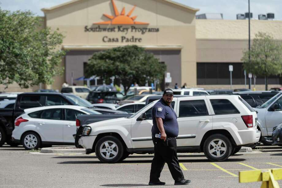 An agent last year patrols the area around a former Walmart in Brownsville converted to hold immigrant children. A reader suggests that route — converting empty big-box stores — could offer better facilities for adults or families seeking asylum. Photo: Los Angeles Time File Photo / Los Angeles Times
