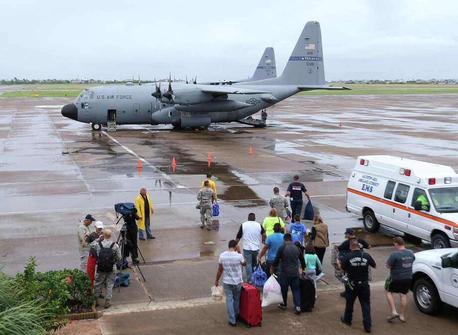 Dickinson flood evacuees boarding an airplane at Scholes International Airport on Monday, August 28, 2017, in Galveston. Texas Air National Guard planes were taking these flood evacuees to other cities after they spent Sunday night at a Galveston shelter, an example of how citizen airmen help during disasters. Photo: Yi-Chin Lee / Houston Chronicle /Yi-Chin Lee / Houston Chronicle 2017