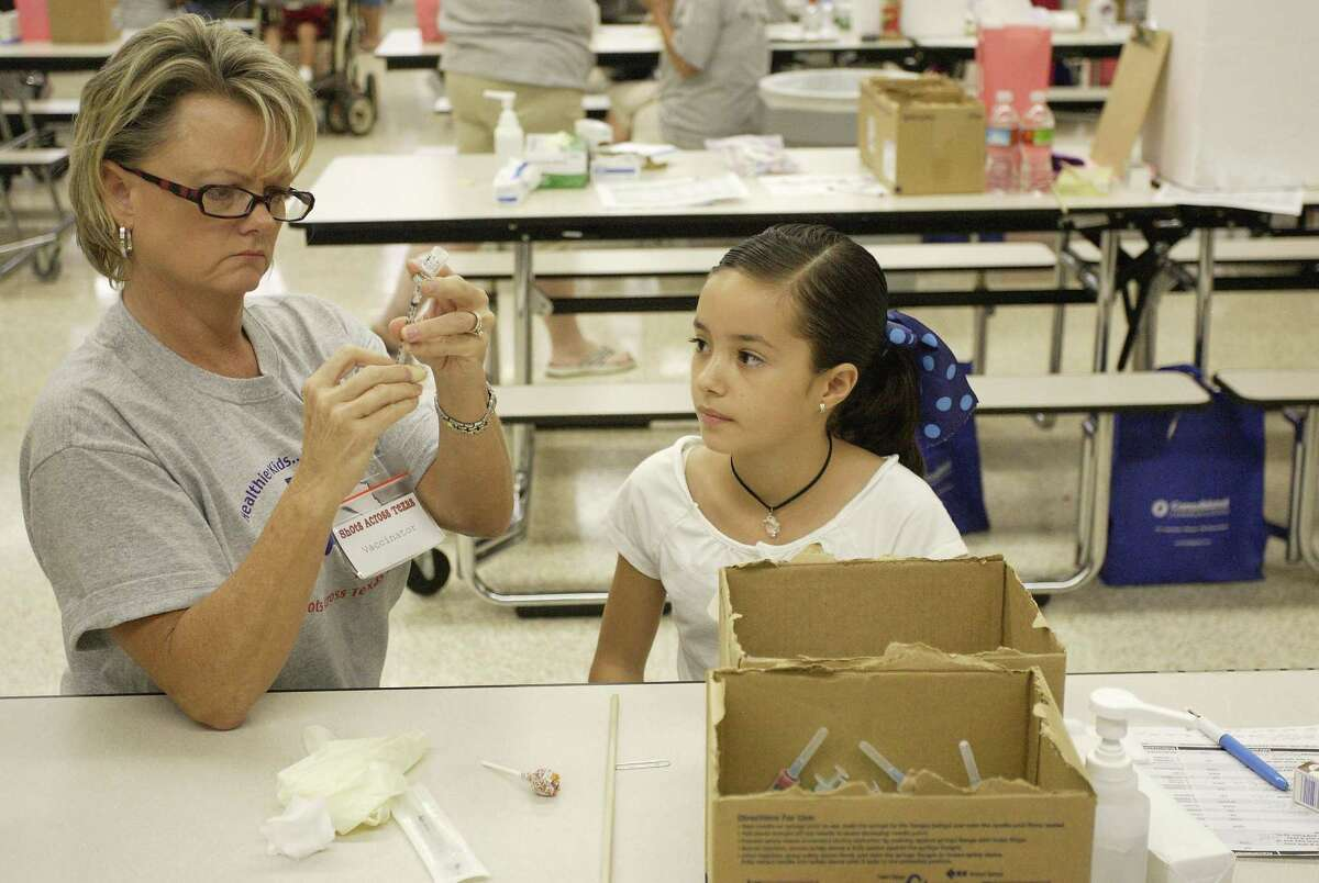 Lilian Gitani, 10, of The Woodlands, watches as nurse Jeri Tolliver prepares to administer a tuberculin skin test to her during the Montgomery County Hospital District's 15th annual Shots Across Texas free immunization event last year in Conroe. More Texas parents are claiming exemptions on getting their kids vaccinated.