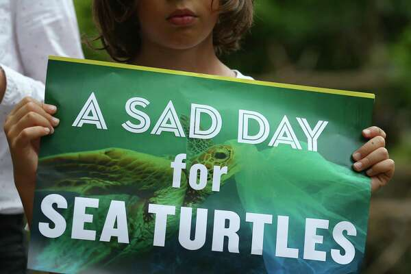 Merchants might be applauding a Texas Supreme Court ruling against local ordinances on plastic bag bans, supporters of the environment not so much. Eight-year-old Vishwa Mankad holds up a sign during a press conference regarding the court's ruling at Woodland Park June 22 in Houston.