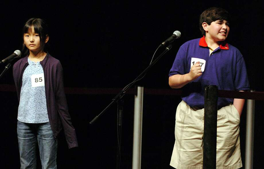 """Spelling Bee winner George Hornedo, right, reacts to correctly spelling the word """"shibboleth"""" in 2004 at Trinity University. According to one account, being unable to pronounce the word cost thousands of lives in one example of extreme tribalism. Photo: KIN MAN HUI /SAN ANTONIO EXPRESS-NEWS / SAN ANTONIO EXPRESS-NEWS"""