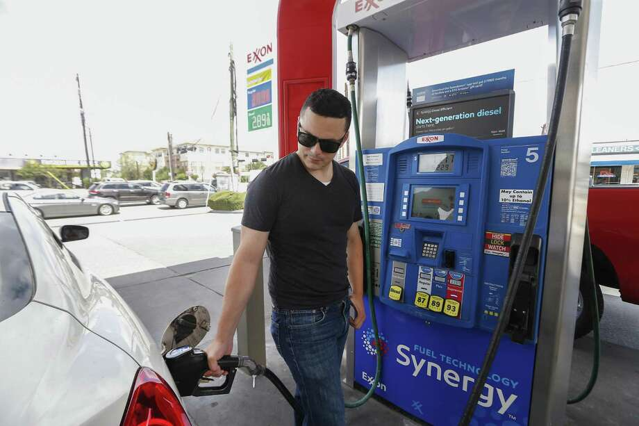 Gasoline prices are expected to continue rising for the next few weeks. In this file photo, Fili Gonzalez fills his tank up at Timewise Food Store, 2539 Bissonnet St.,June 29, 2018, in Houston.  NEXT: See gasoline prices in Texas biggest cities.  Photo: Steve Gonzales, Staff / Houston Chronicle / © 2018 Houston Chronicle