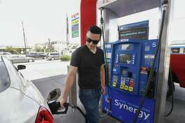 Fili Gonzalez fills his tank up at Timewise Food Store, 2539 Bissonnet St., as higher gas prices are expected ahead of July 4th Friday, June 29, 2018, in Houston. Gonzalez said that he did not have any plans of leaving town for the holiday. ( Steve Gonzales / Houston Chronicle )