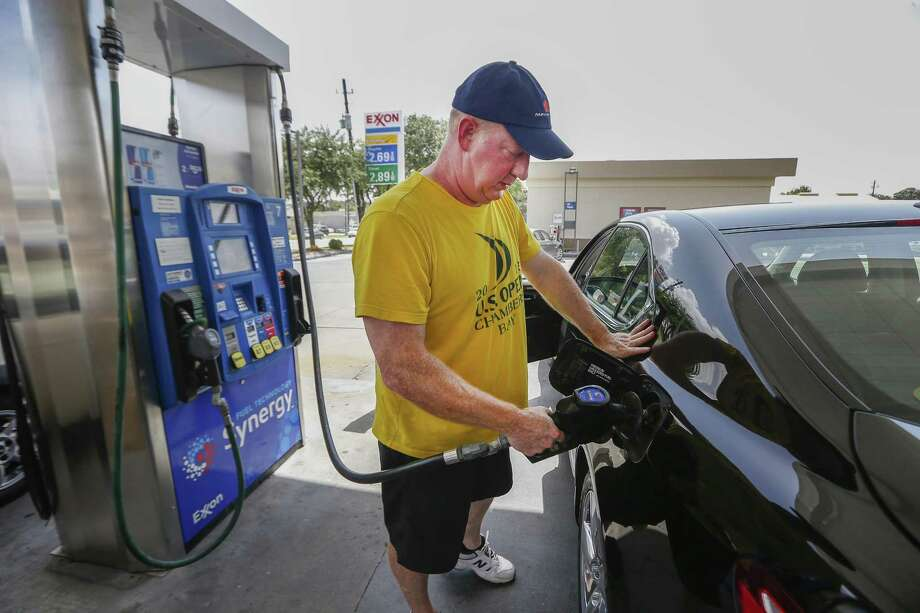 Gas prices in Houston fell again as oil prices were dragged down by worries about a recession last week. Alex Hinricks fills his tank up at Timewise Food Store, 2539 Bissonnet St., in this 2018 file photo.  NEXT: See gasoline prices in Texas' biggest cities.  Photo: Steve Gonzales, Staff / Houston Chronicle / © 2018 Houston Chronicle