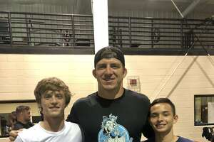 Incoming senior Reid Kimes and sophomore-to-be Micah White are Kingwood's first grapplers to leave the state to attend one of coach J Robinson's prestigious wrestling camps.