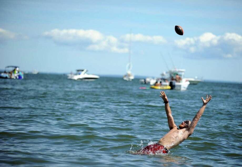 Cooling off in the Long Island Sound during off Seaside Park is one way to survive a heat advisory called for Sunday and Monday. Photo: Autumn Driscoll / Autumn Driscoll / Connecticut Post freelance