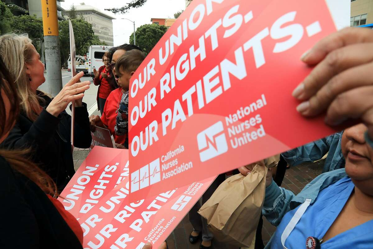 Members of the California Nurses Association protest in San Francisco on Wednesday, June 27, 2018, after a Supreme Court ruling seen as a major blow to organized labor. In a 5-4 decision, the court ruled that government workers cannot be required to pay for collective bargaining, which could cost public unions tens of millions of dollars. (Jim Wilson/The New York Times)