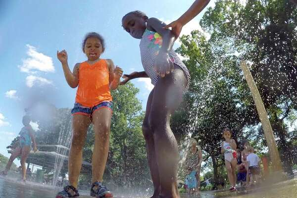 Khloe Mena, 5, of Norwalk and Kailyn Bryant, 4, of Stamford cool off from a summer heatwave, as they play at the Splash Pad at Scalzi Park on June 29, 2018 in Stamford, Connecticut.