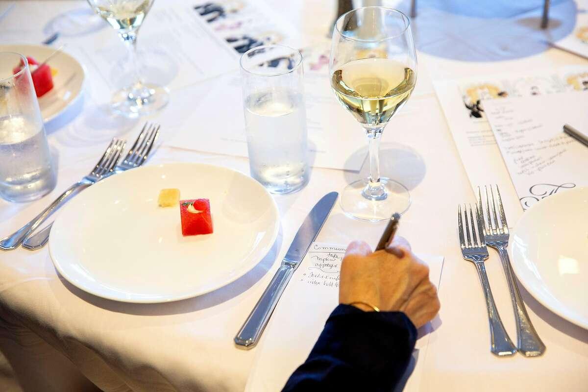 Sarita Gomez writes down notes during an etiquette class at the Fairmont San Francisco Hotel, Tuesday, June 26, 2018, in San Francisco, Calif.