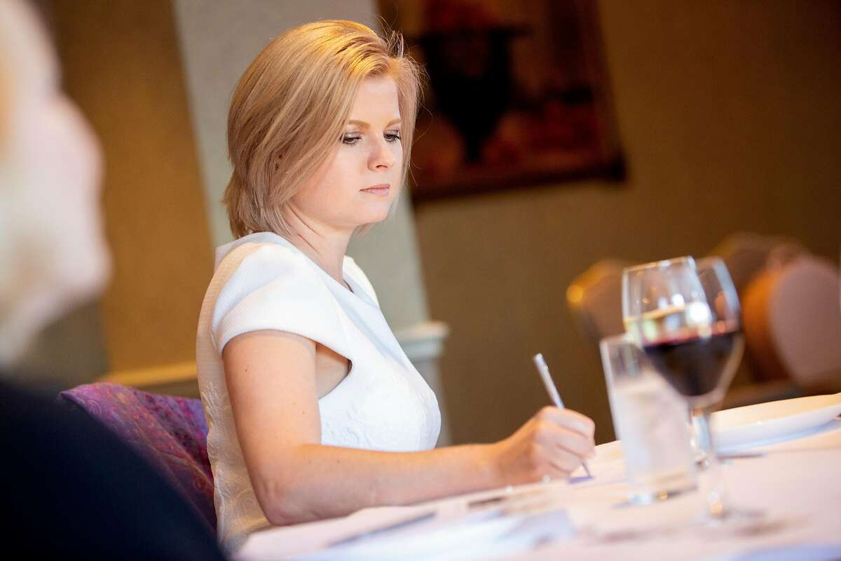 Ksenia Closson writes down notes during an etiquette class at the Fairmont San Francisco Hotel, Tuesday, June 26, 2018, in San Francisco, Calif.