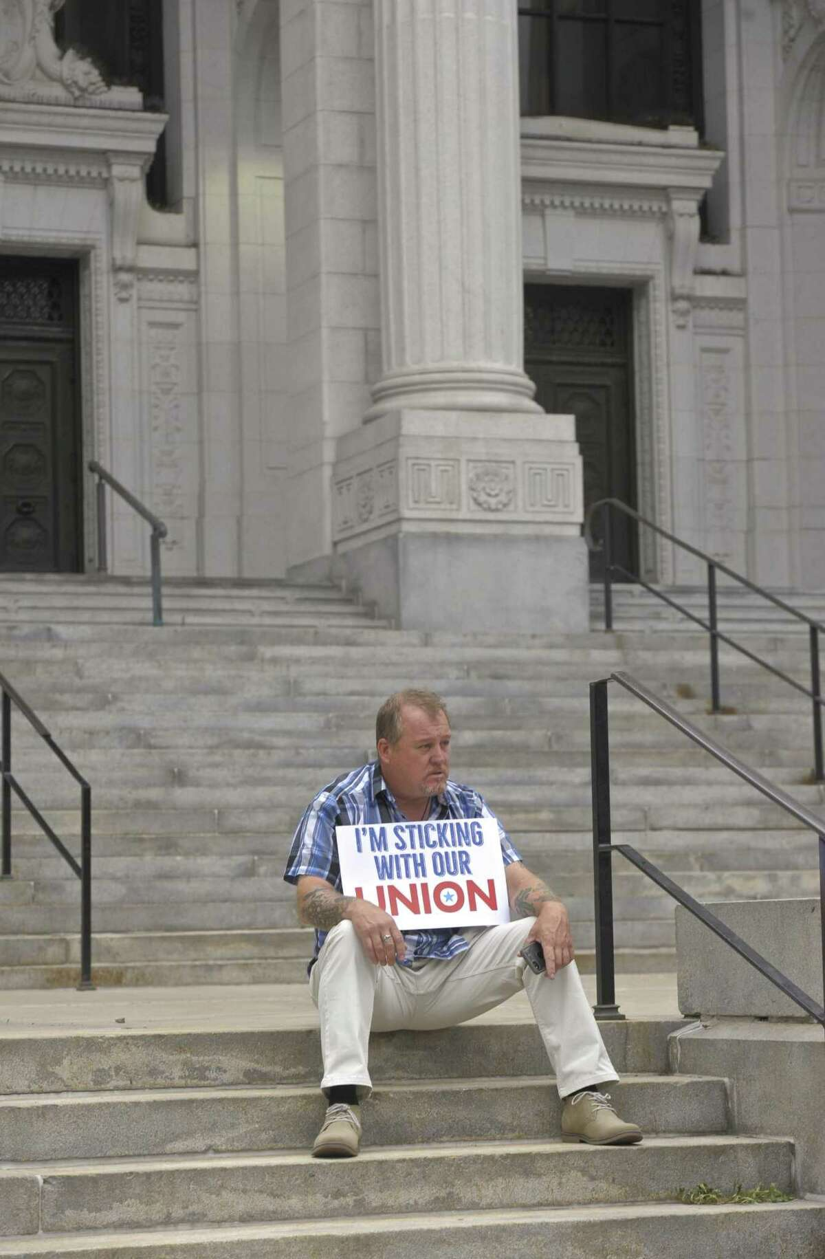 David Roche, of Bristol, president of Connecticut State Building Trades, sits on the steps of the Connecticut Supreme Court on Wednesday afternoon, waiting for an organized labor news conference in response to the U.S. Supreme Court on Janus v. AFSCME Council case.