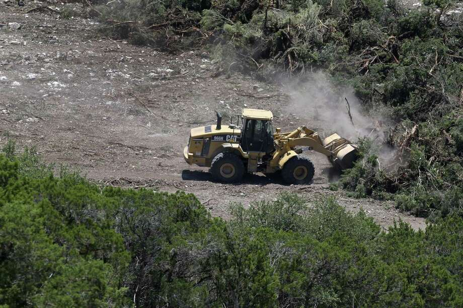 Heavy equipment clears land. This is the view   from Washita Way northwest of Loop 1604 and Interstate 10. Photo: William Luther / San Antonio Express-News / © 2018 San Antonio Express-News