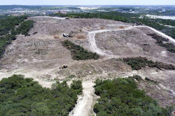 Large equipment clears land Wednesday, June 27, 2018 seen from Washita Way north west of the Loop 1604 and I-10 intersection on San Antonio's north side.