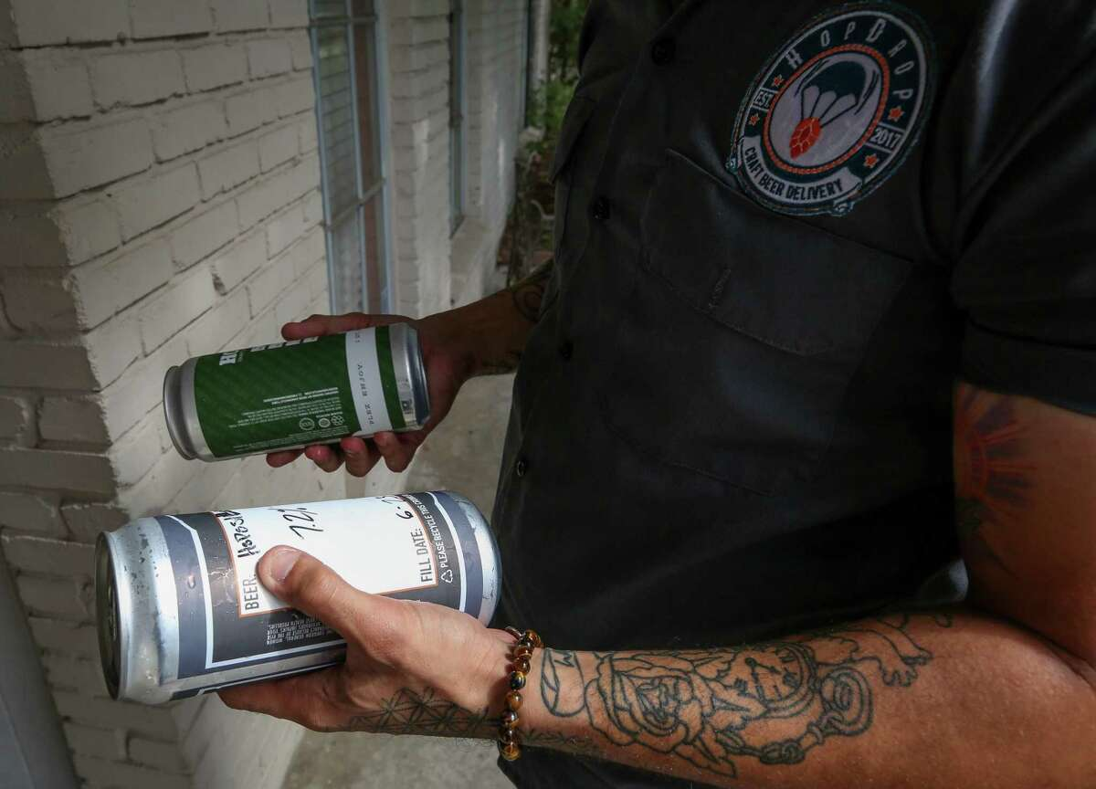 Ricardo Pardillo, who works with HopDrop, delivers two cans of beer to a clients residence Friday, June 29, 2018, in Houston. HopDrop launched late last year to provide home delivery of local and hard-to-find beers. H-E-B and its delivery service Favor announced Friday that the grocer will now offer home delivery of beer and wine. ( Godofredo A. Vasquez / Houston Chronicle )