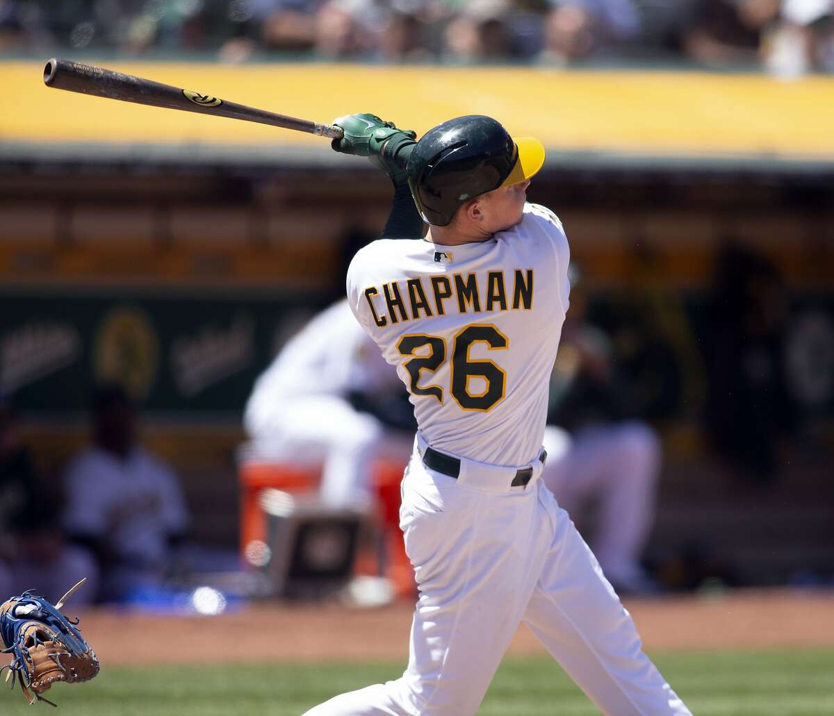 Oakland Athletics Matt Chapman follows through on a solo home run against the Tampa Bay Rays during the seventh inning of a baseball game Thursday, May 31, 2018, in Oakland, Calif. The A's won 7-3. (AP Photo/D. Ross Cameron)