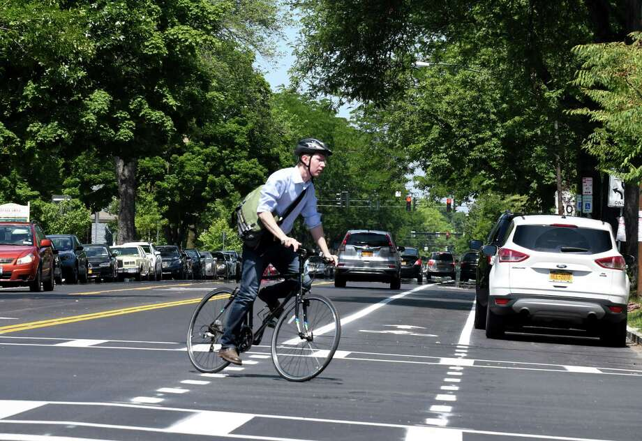 A cyclist crosses Madison Ave. at S. Lake on Friday, June 29, 2018, in Albany, N.Y. Mayor Kathy Sheehan held a press conference to highlight the completion of the major components of the second and final phase of the Madison Avenue Street Calming project. (Will Waldron/Times Union) Photo: Will Waldron / 20044232A
