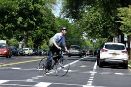 A cyclist crosses Madison Ave. at S. Lake on Friday, June 29, 2018, in Albany, N.Y. Mayor Kathy Sheehan held a press conference to highlight the completion of the major components of the second and final phase of the Madison Avenue Street Calming project. (Will Waldron/Times Union)